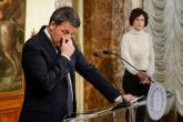 epa05660299 The Italian Prime Minister, Matteo Renzi, speaks at the Palazzo Chigi in Rome, Italy, 04 December 2016 after the referendum on constitutional reform, with his wife Angese Landini in the background. Matteo Renzi has announced his resignation after exit polls on 04 December 2016 suggest a 'No' vote victory in a crucial referendum to which Renzi had tied his political future. The referendum is considered by the government to end gridlock and make passing legislation cheaper by, among other things, turning the Senate into a leaner body made up of regional representatives with fewer lawmaking powers. It would also do away with the equal powers between the Upper and Lower Houses of parliament - an unusual system that has been blamed for decades of political gridlock.  EPA/GREGOR FISCHER